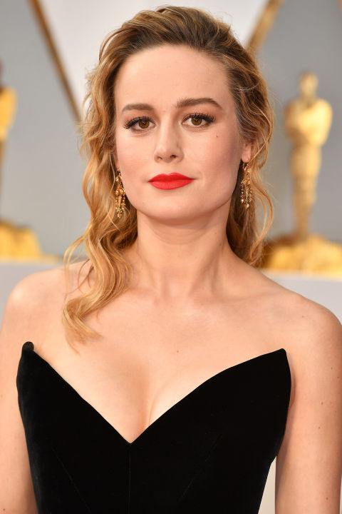 Some critics think a black dress is snoozy on the red carpet. Of course that's not true. Especially when you pair it with a bright, matte orange-red Nars lipstick.