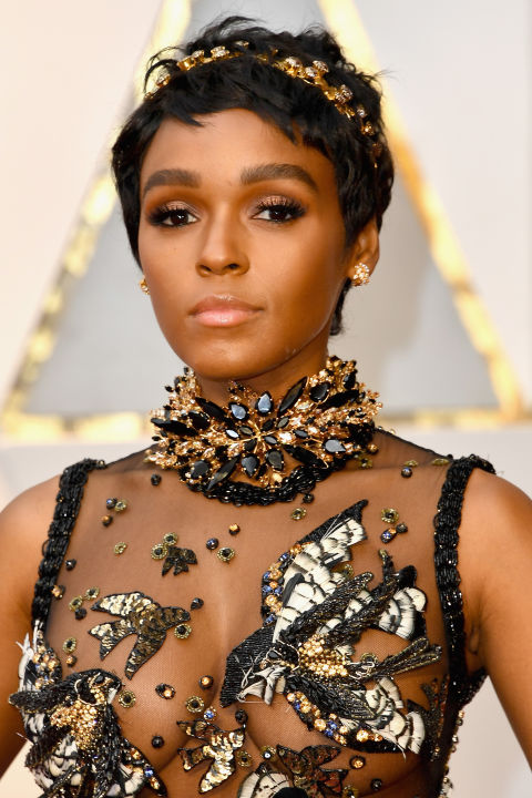 Monáewas dripping in metallics, sparkles, and embellishments of every shape, size, and color. But it was her new cropped hair, metallic shadow, and strong brows that stole the show.