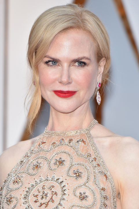 Kidman's hair, Armani gown, and skin color are all in the same color family, which is why her pop of red lipstick was such a flawless choice.