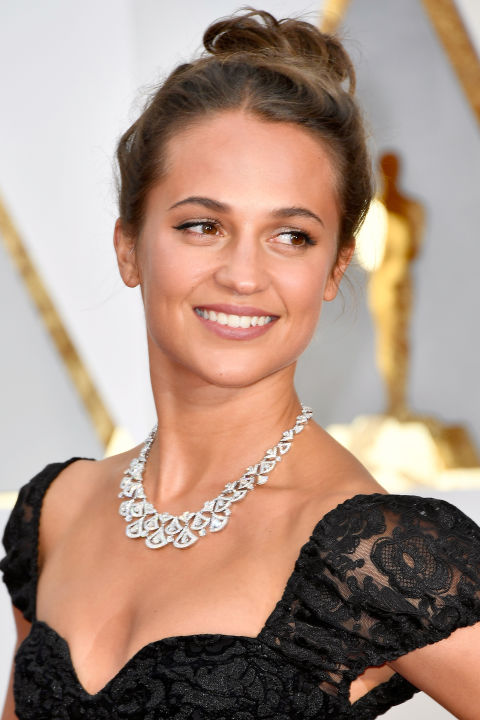It wouldn't be the first time Vikander rocked a cool-girl top knot on the red carpet. But with diamonds this sparkly, are you even looking at her hair?