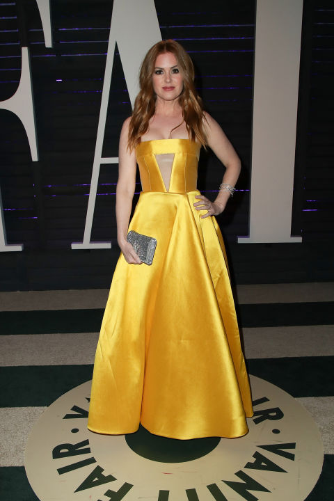 Isla Fisher paid tribute to Beauty and the Beast in yellow Alex Perry.