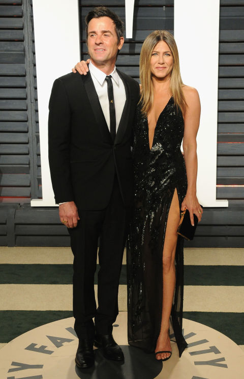 Justin Theroux and Jennifer Aniston, in Atelier Versace